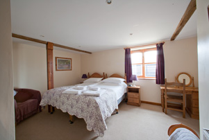 Double bedroom with 6' zip/link bed and single bed